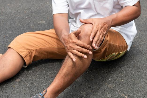 Senior man asian leg pain during jogging at the park.