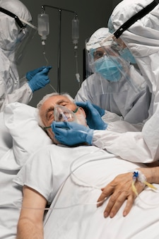 Senior man breathing with a special equipment at the hospital