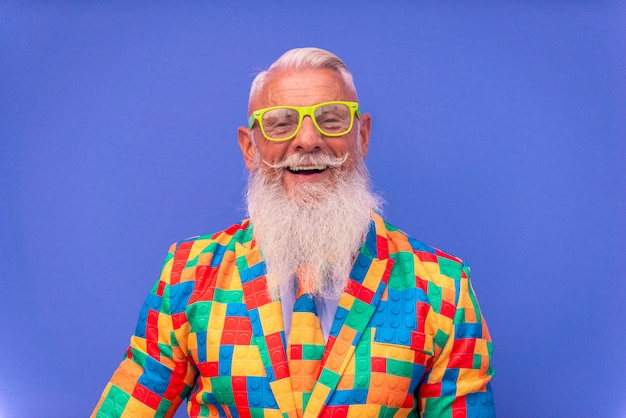 Senior man in extravagant colorful clothes