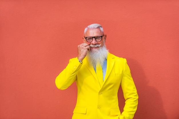 Senior man in extravagant yellow clothes
