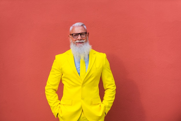 Senior man in extravagant yellow suit