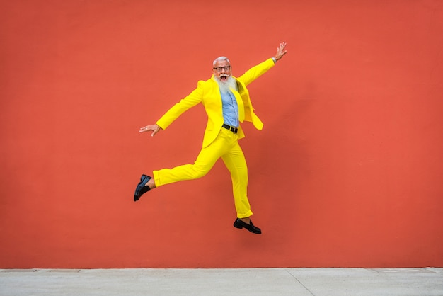 Senior man in extravagant yellow suit