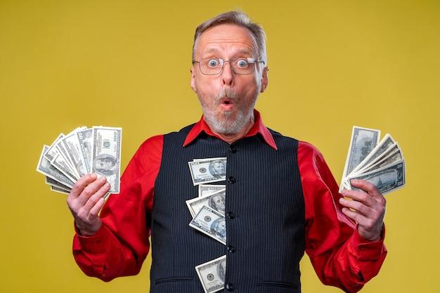 Senior man guy won the lottery, fan of money near face of old man.