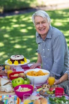 Senior man having picnic