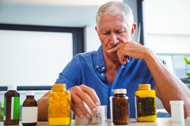 Senior man holding medicine