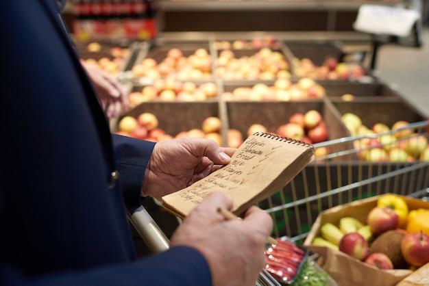 Senior man holding shopping list