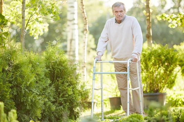 Senior man leaning on walker