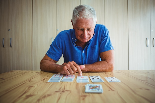 Senior man pointing at a card
