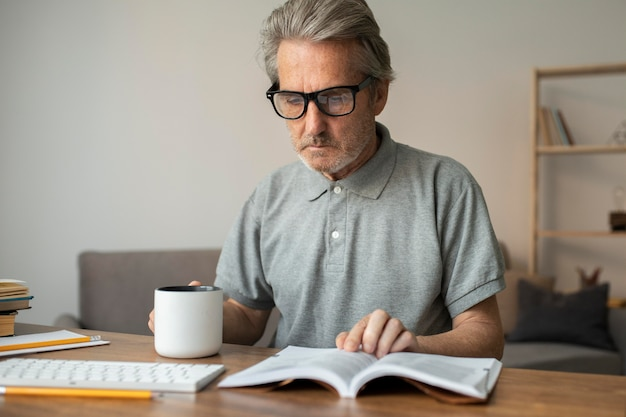 Senior man reading his lesson for school