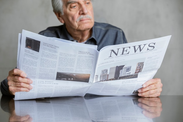 Senior man reading the news during coronavirus pandemic