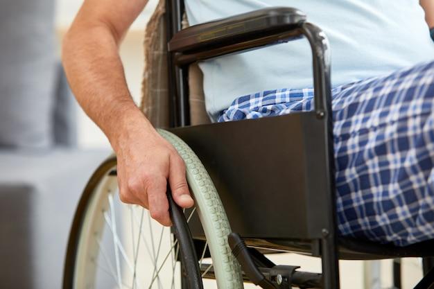 Senior man riding on wheelchair