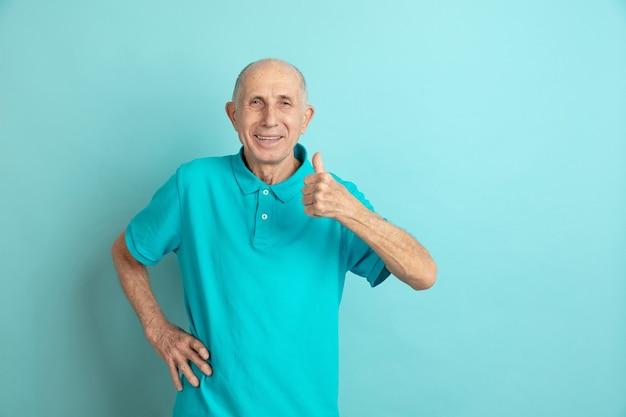 Senior man showing thumb up