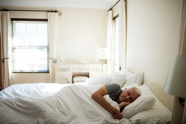 Senior man sleeping in the bedroom at home