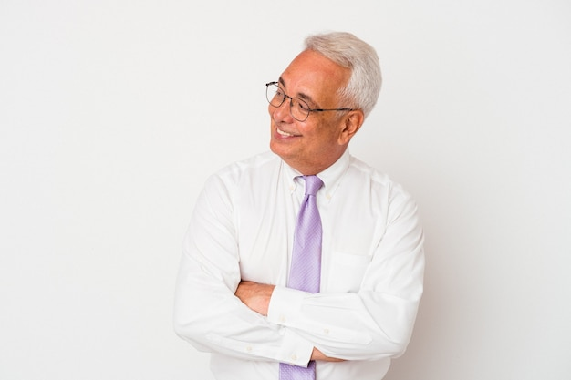 Senior man smiling confident with crossed arms.