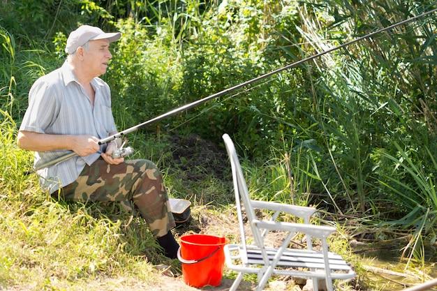Senior man spending a relaxing day fishing