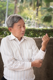 Senior man suffering from elbow joint pain