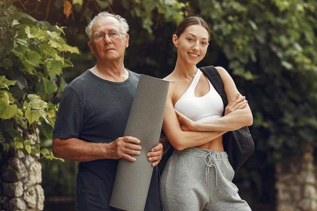 Senior man at summer park. grangfather with granddaughter.