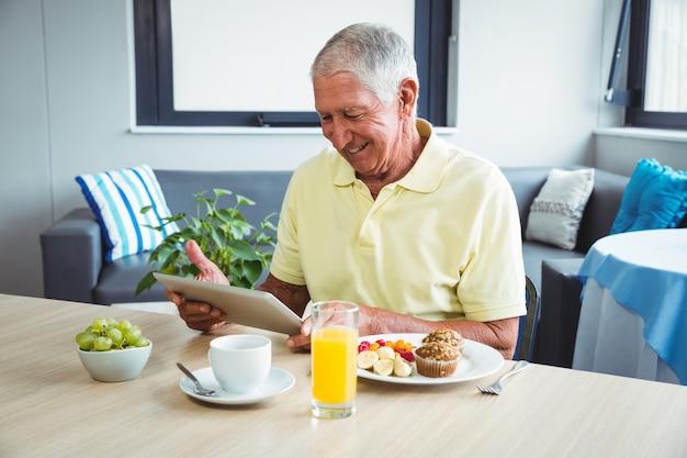Senior man using a digital tablet