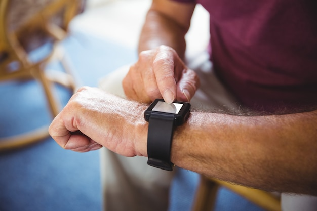 Senior man using a smart watch