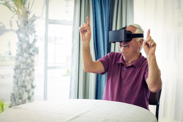 Senior man wearing virtual glasses