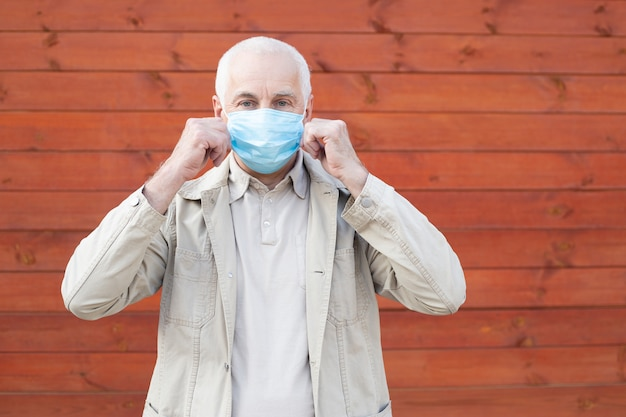 Senior man wears protective mask against infectious diseases and flu, health care concept. coronavirus quarantine.