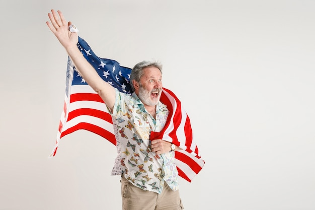 Senior man with the flag of united states of america