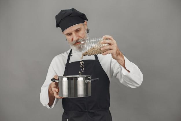 Senior man with jar of oatmeal.