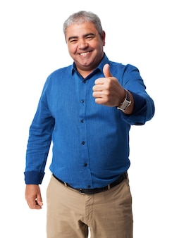 Senior man with thumb up
