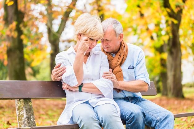 Senior man and woman being sad