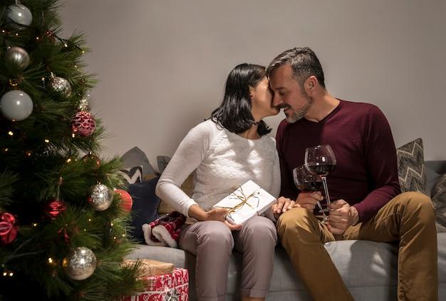 Senior man and woman celebrating christmas
