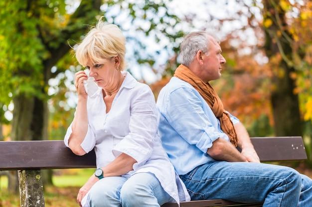 Senior man and woman having argument