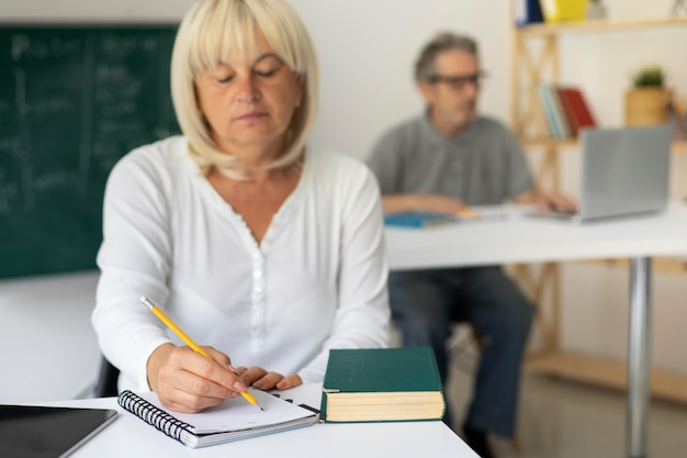 Senior man and woman paying attention in class