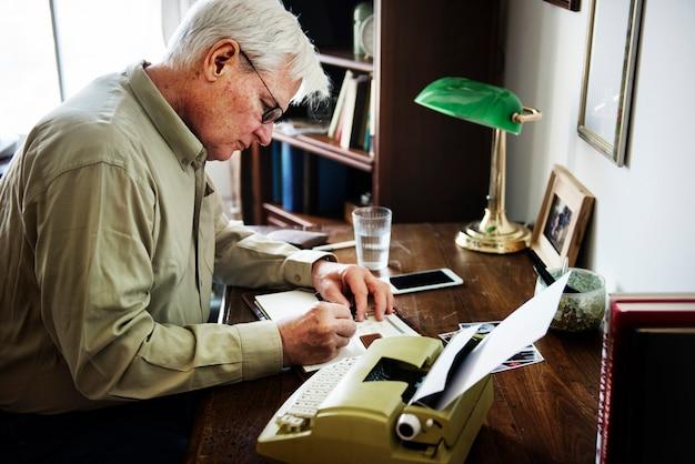 Senior man writing