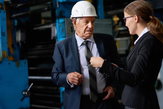 Senior manager in factory workshop