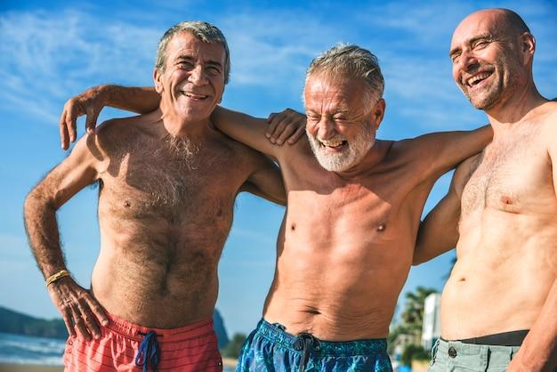 Senior men having fun on the beach