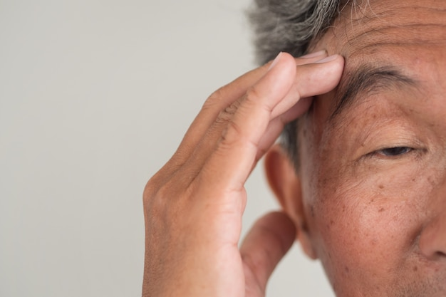 Senior old man suffering from dementia or memory loss