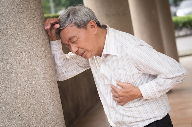 Senior old man suffering from a heart attack