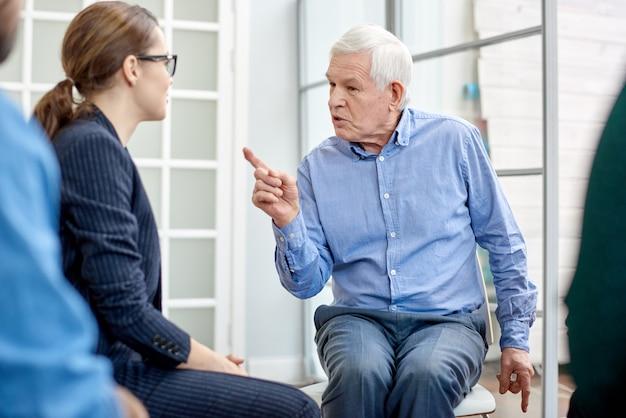 Senior patient communicating with psychologist