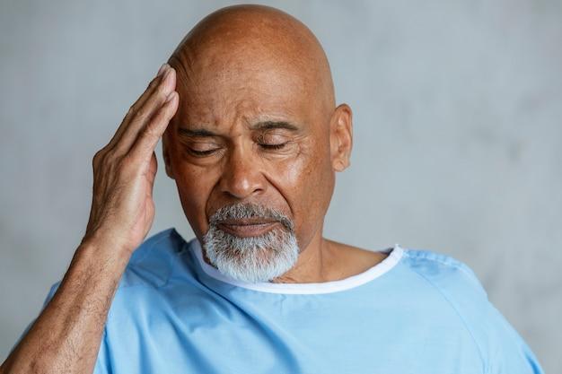 Senior patient having a headache