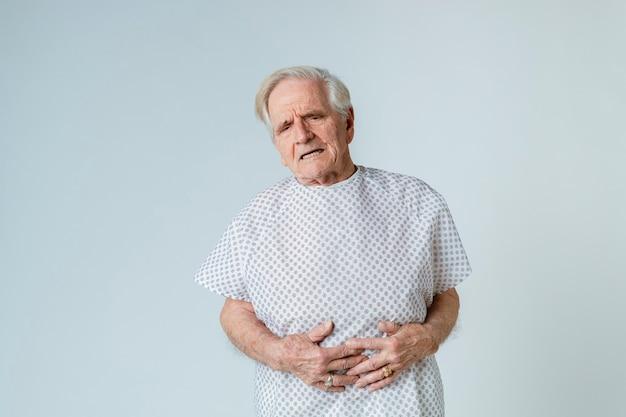 Senior patient having a stomach ache