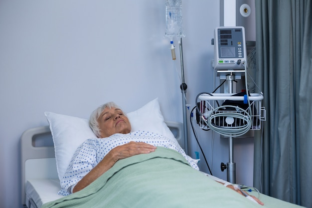 Senior patient lying on bed