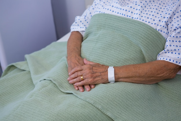 Senior patient relaxing on bed