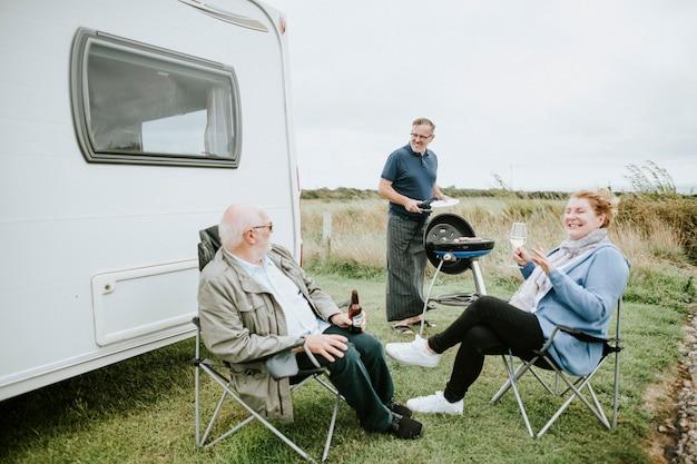 Senior people enjoying outside a trailer