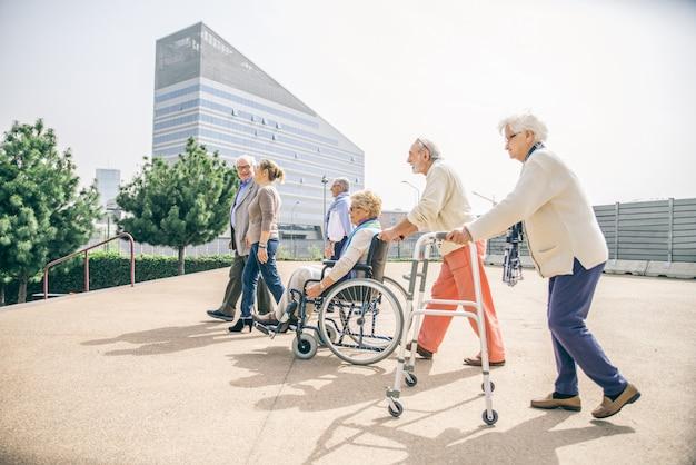 Senior people walking outdoors