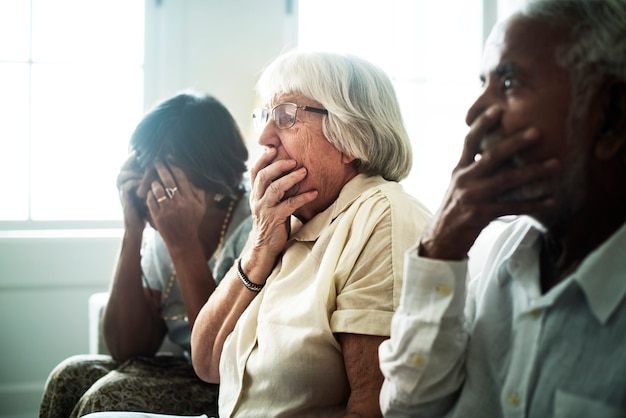 Senior people with a horrified reaction