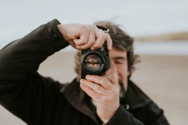 Senior photographer takes a nature landscape shot