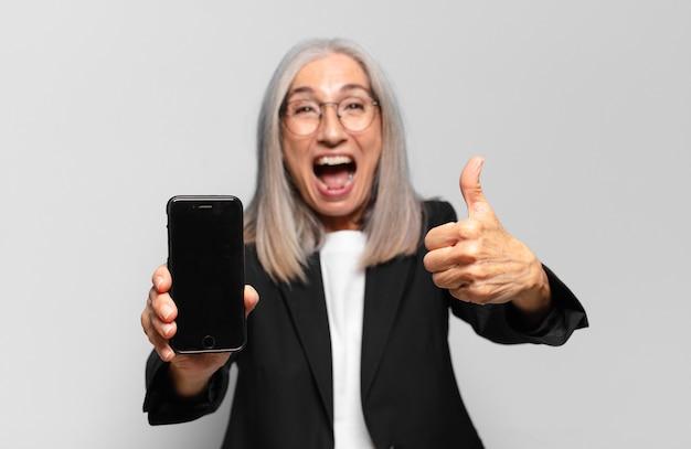 Senior pretty businesswoman with a smart phone.