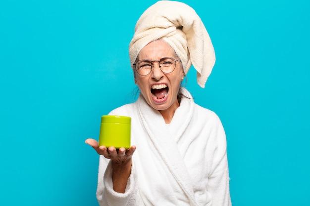 Senior pretty woman after shower wearing bathrobe
