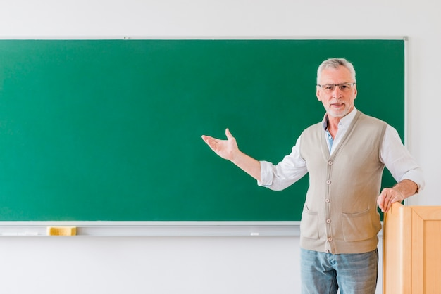Senior professor pointing at blackboard