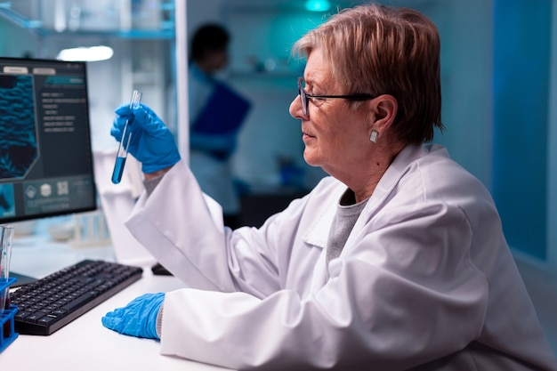 Senior scientist analyzing test with with sample in chemistry facility development